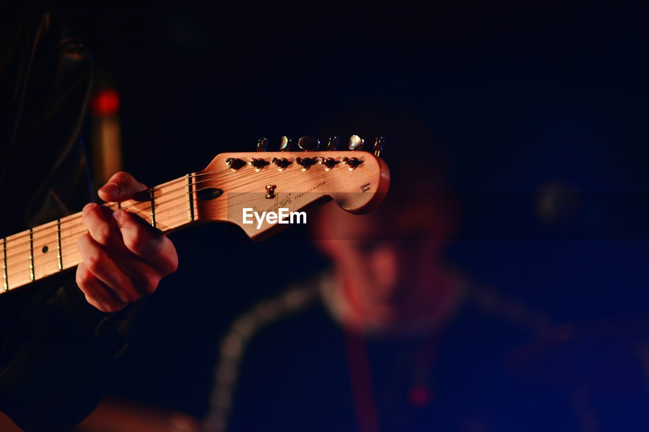 music, musical instrument, playing, musician, musical instrument string, arts culture and entertainment, real people, guitar, one person, performance, fretboard, lifestyles, night, human hand, men, plucking an instrument, close-up, indoors, people