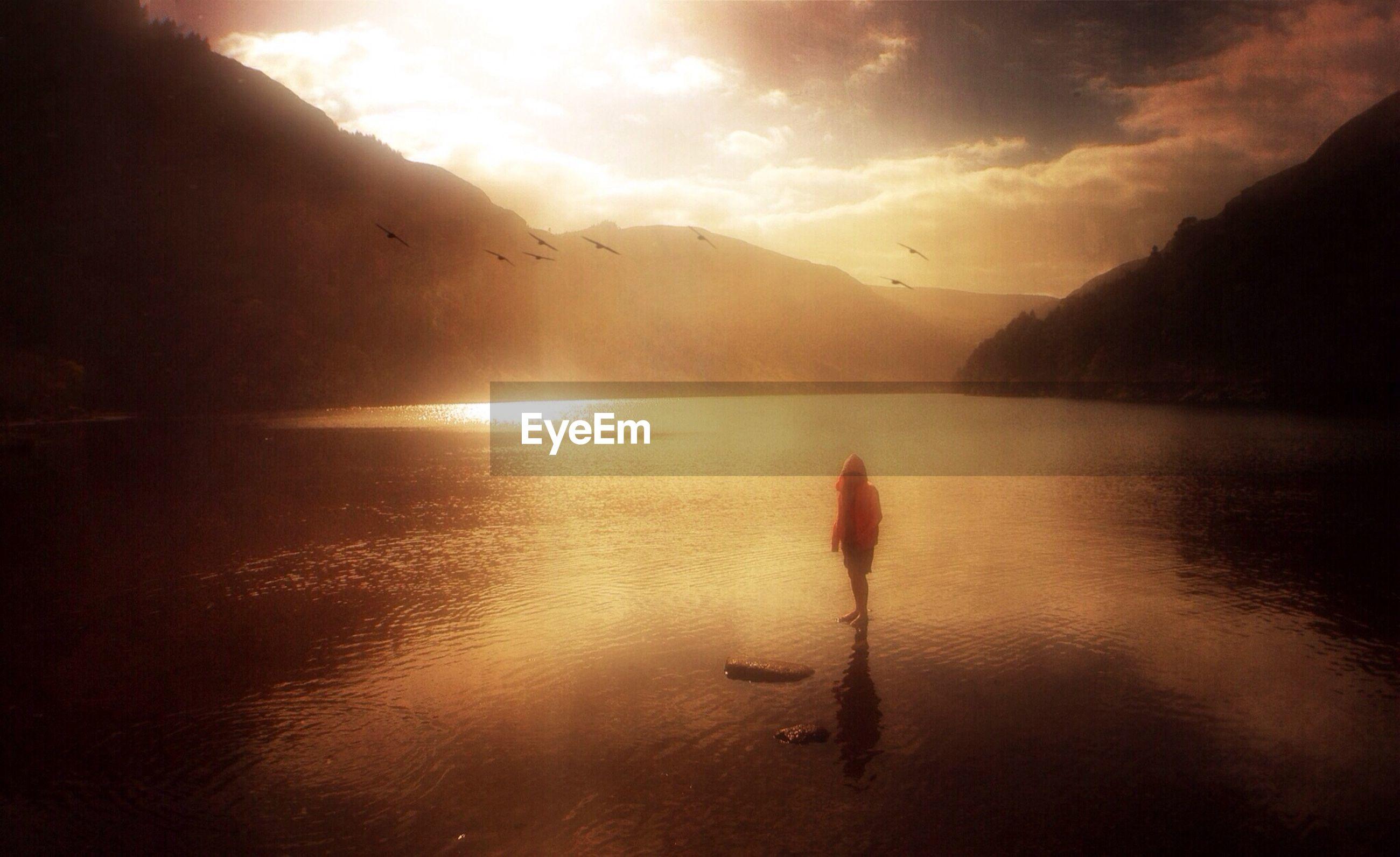 Little girl standing on lakeshore