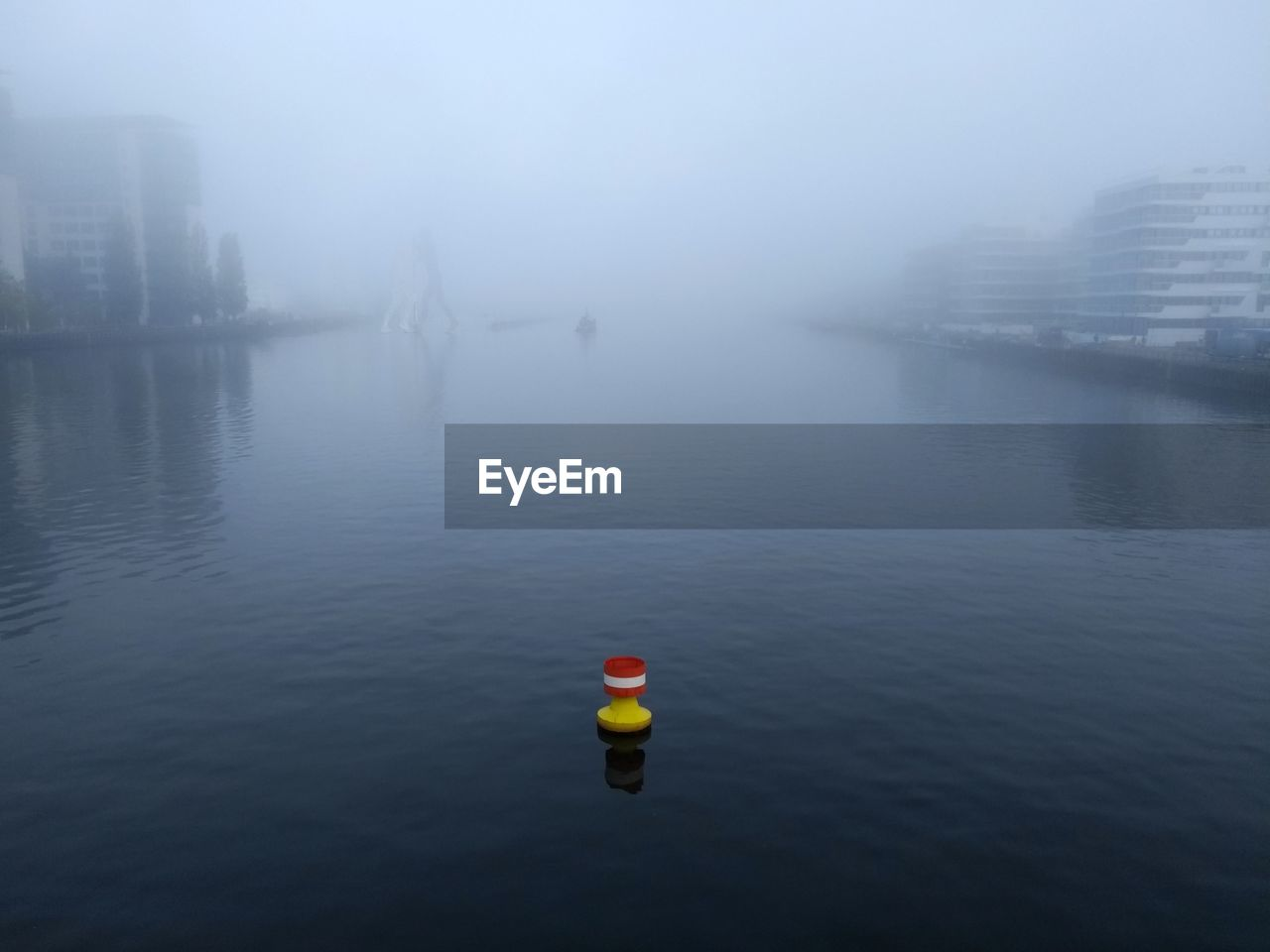 fog, water, waterfront, no people, architecture, nature, building exterior, city, day, built structure, river, outdoors, sky, floating, tranquility, beauty in nature, scenics - nature, floating on water