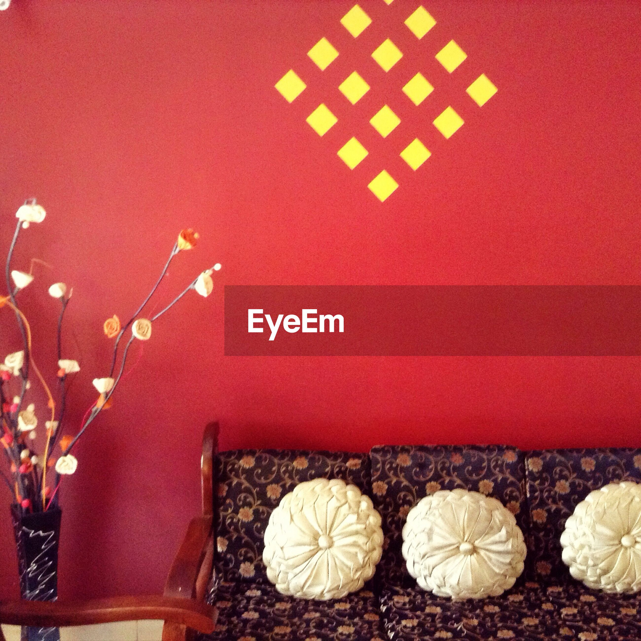 indoors, red, pattern, still life, decoration, wall - building feature, circle, high angle view, geometric shape, close-up, no people, art and craft, shape, design, table, wall, creativity, directly above, heart shape, flooring
