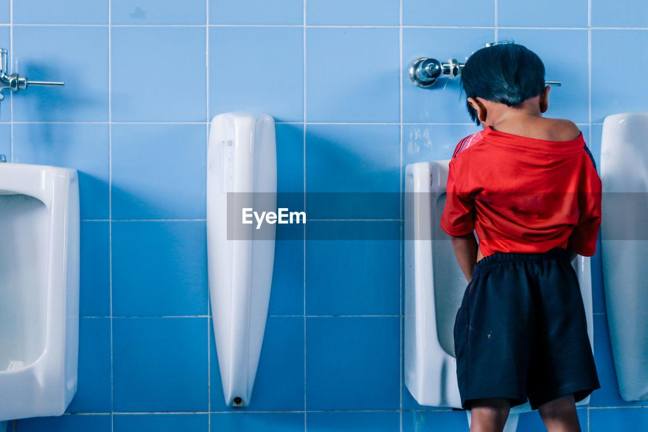 Boy Urinating In Toilet