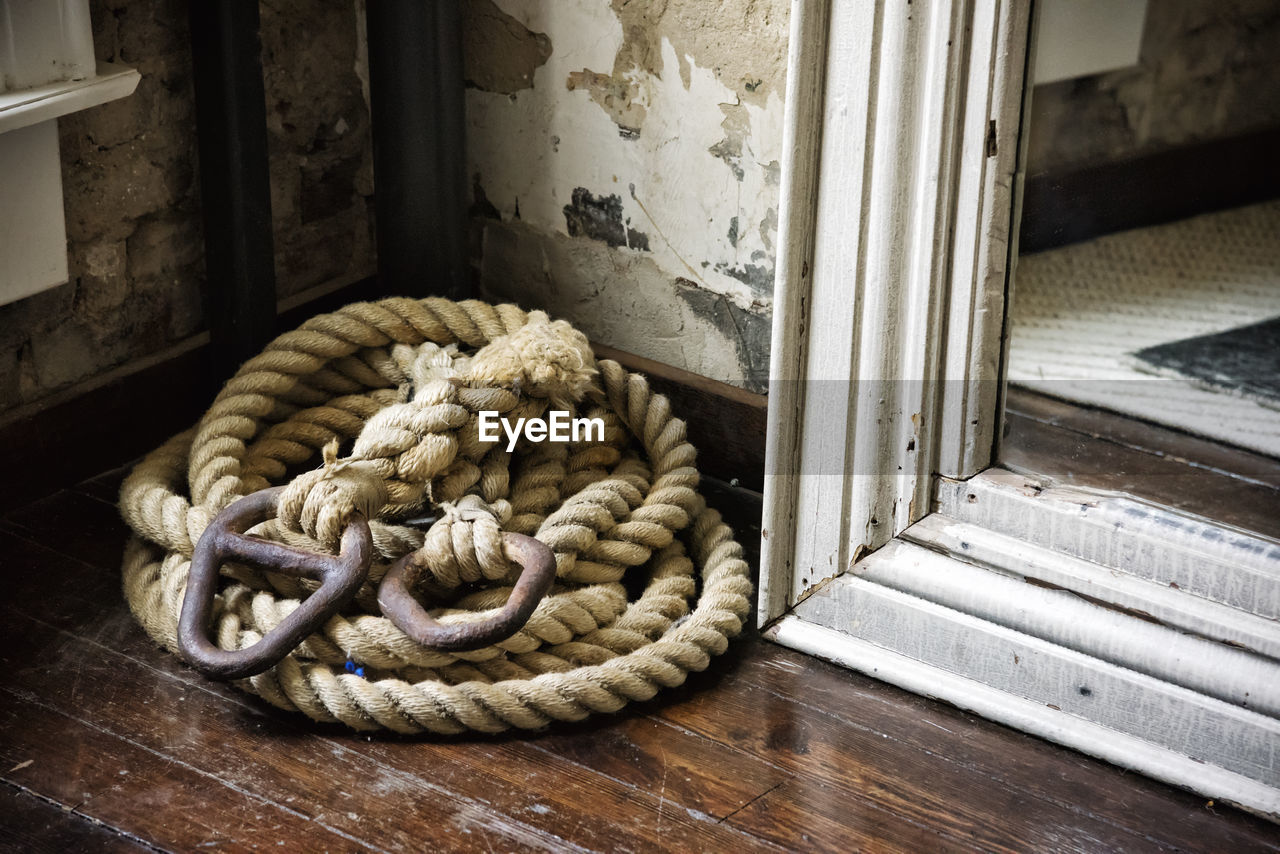 High angle view of rope on hardwood floor