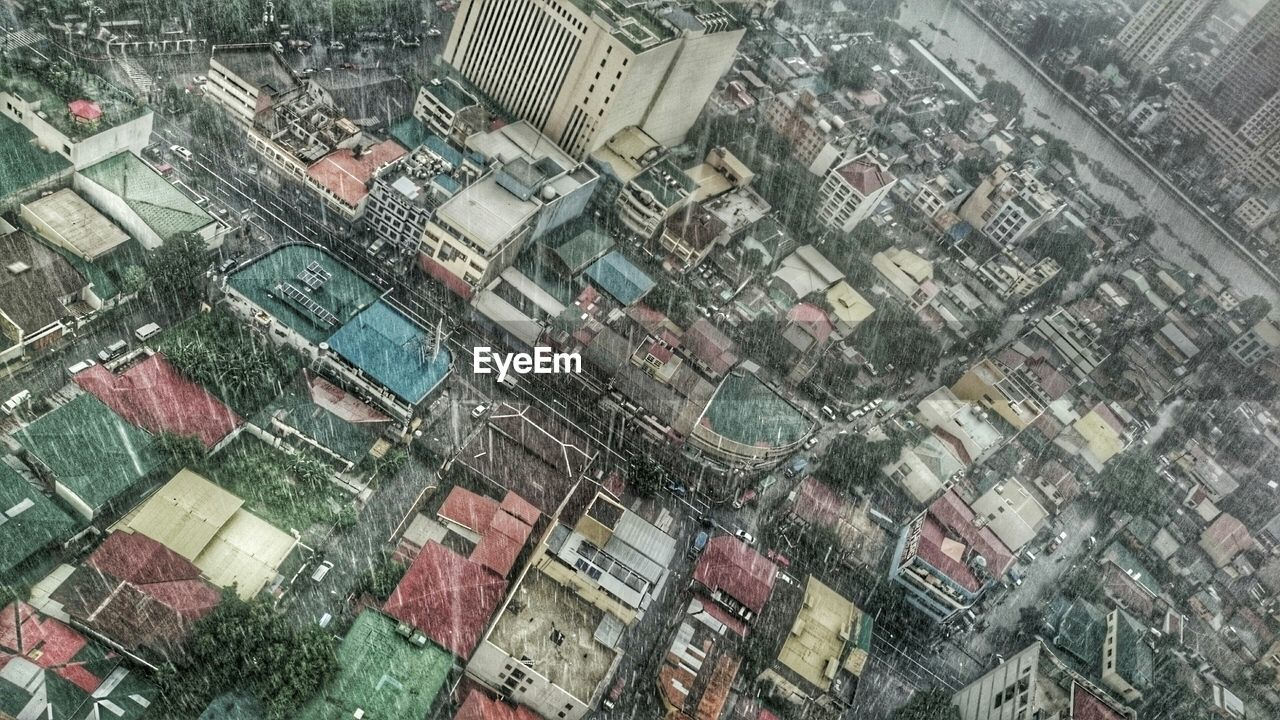 High Angle View Of Buildings In City During Rainy Season