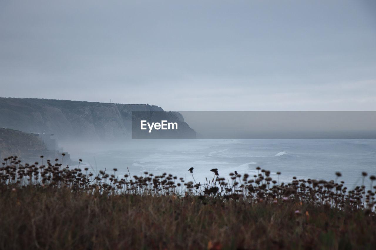 Scenic View Of Ocean Against Sky