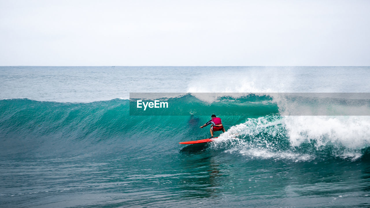 water, sea, motion, horizon over water, sport, horizon, waterfront, aquatic sport, beauty in nature, wave, real people, one person, men, nautical vessel, surfing, sky, scenics - nature, adventure, transportation, jet boat, outdoors, power in nature