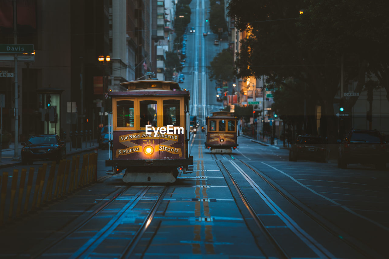 View of illuminated cable car on street