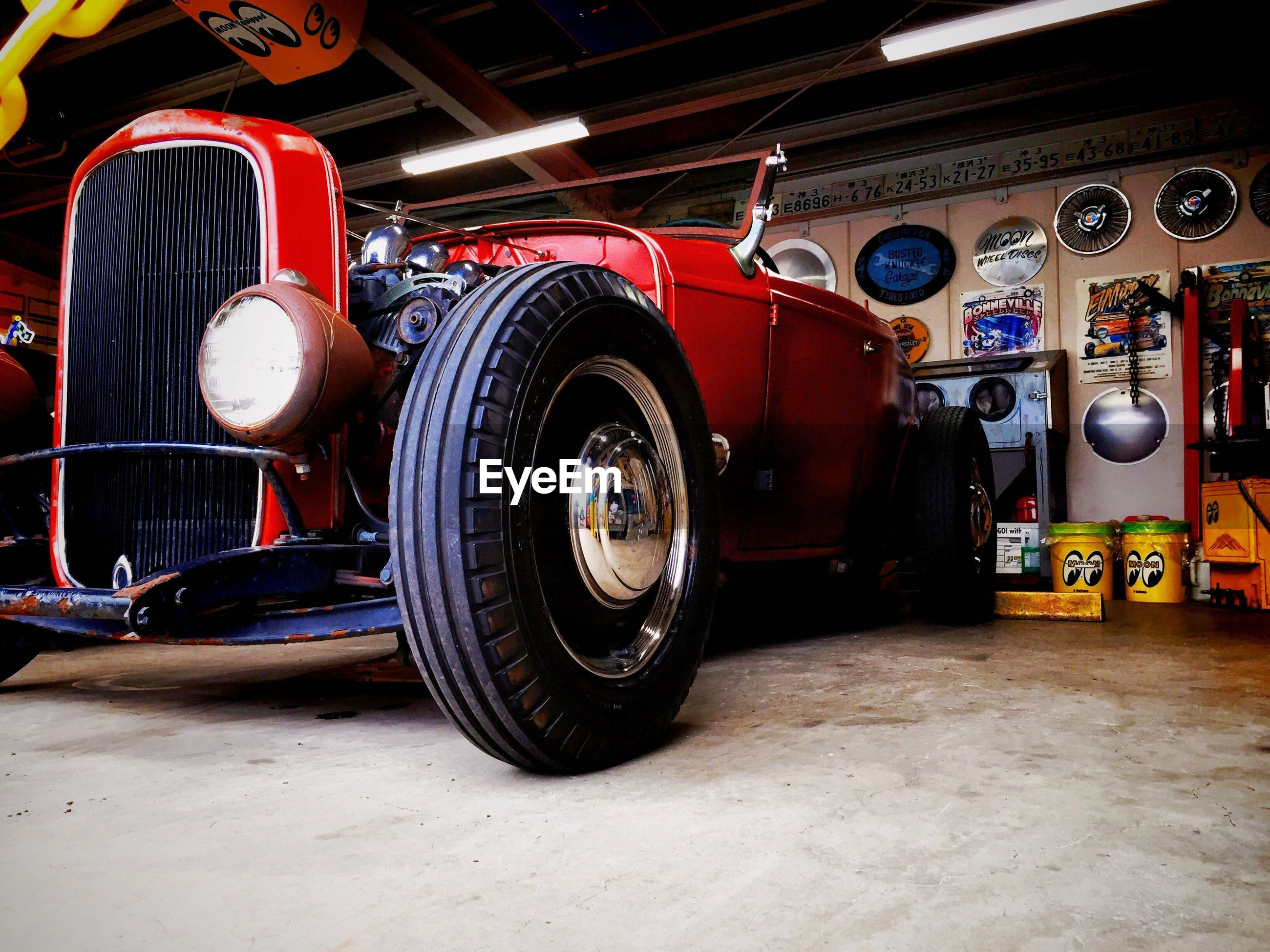 transportation, land vehicle, mode of transport, car, stationary, old-fashioned, wheel, retro styled, indoors, vintage car, travel, no people, parking, parked, red, tire, street, day, vintage