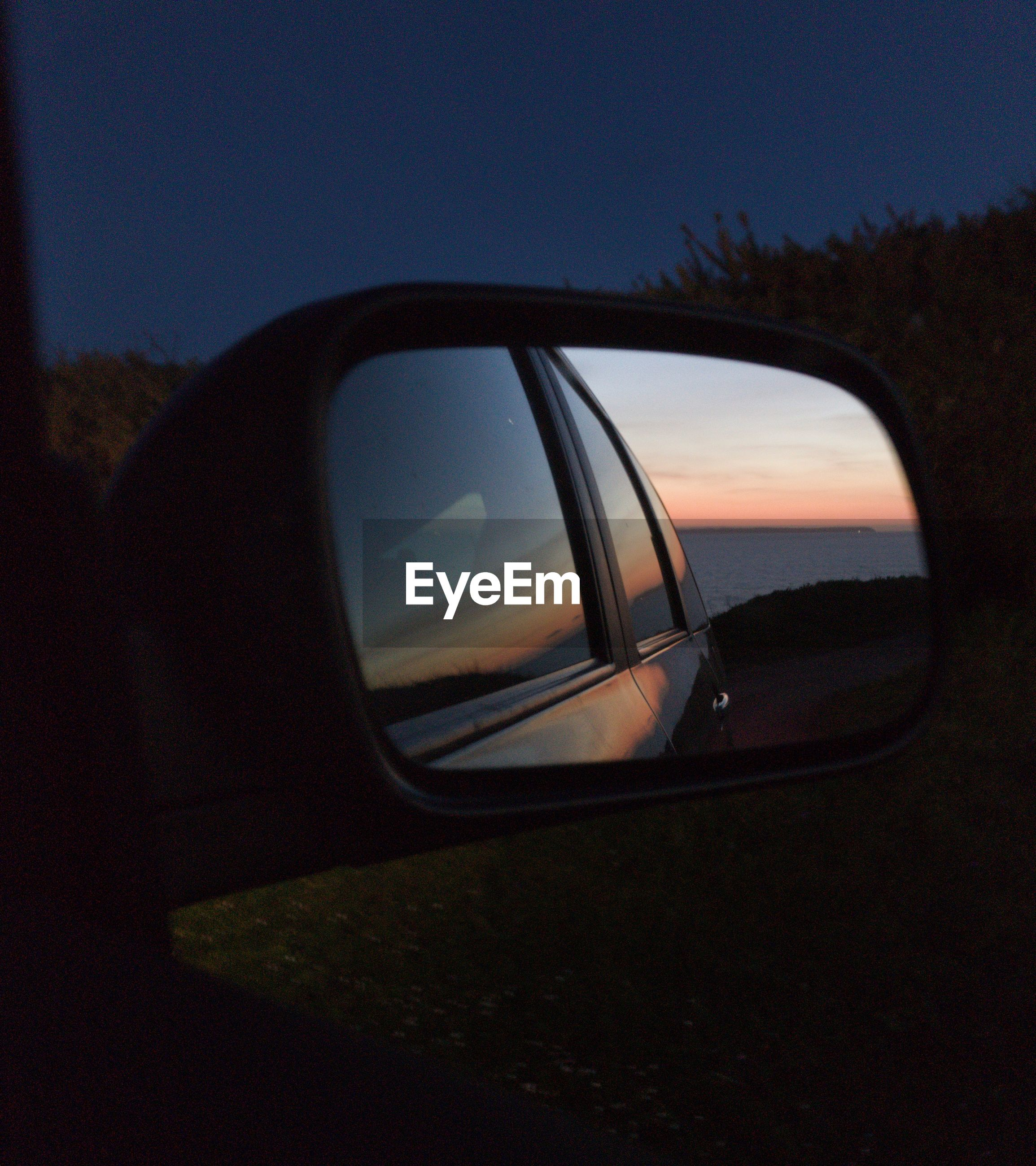 sky, sunset, reflection, land vehicle, nature, mode of transportation, motor vehicle, car, transportation, side-view mirror, no people, outdoors, close-up, orange color, beauty in nature, dusk, plant, travel, sunlight, silhouette
