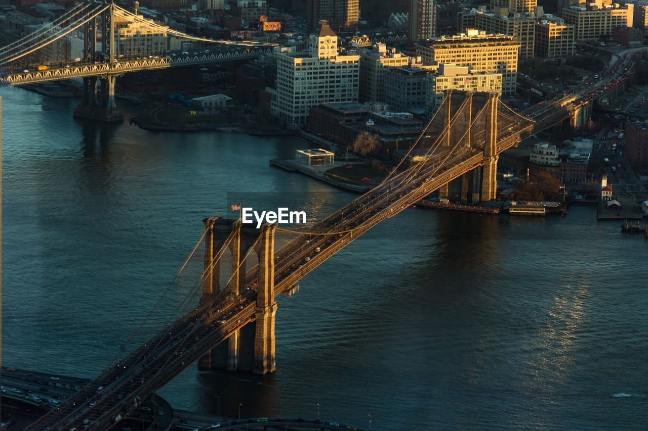 High Angle View Of Bridges Over East River At Sunset