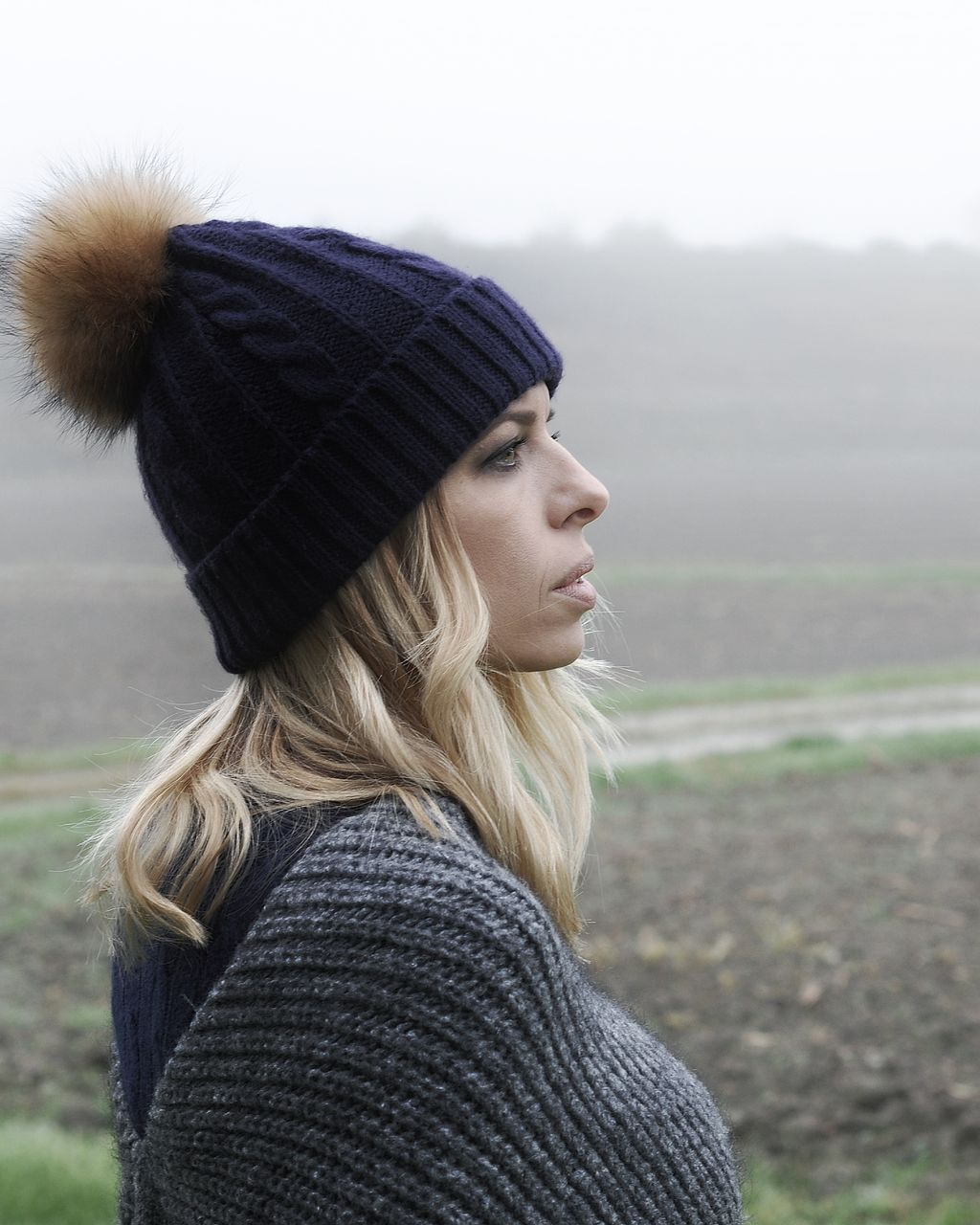 Close-up of woman looking away during winter