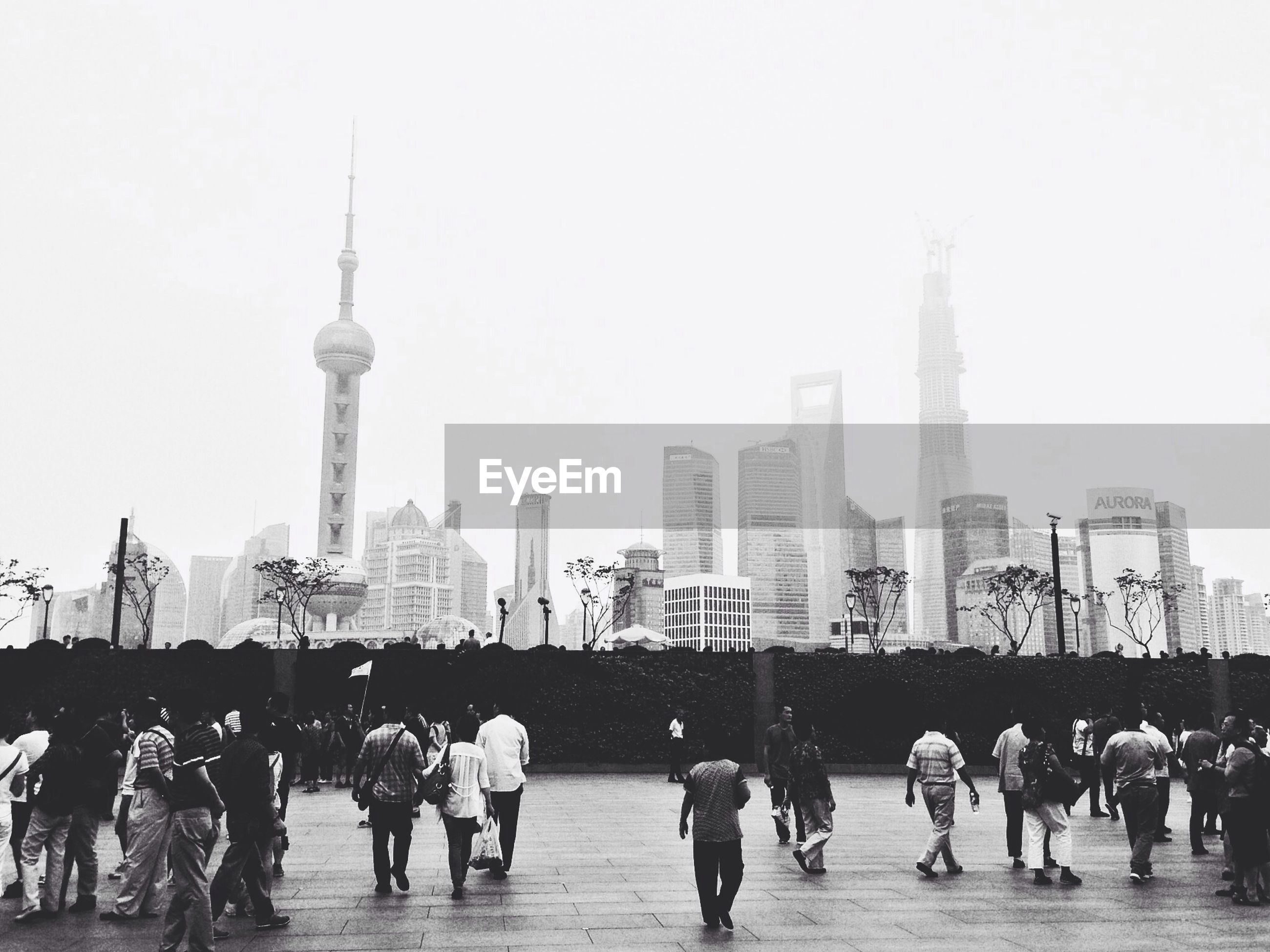People walking in front of cityscape
