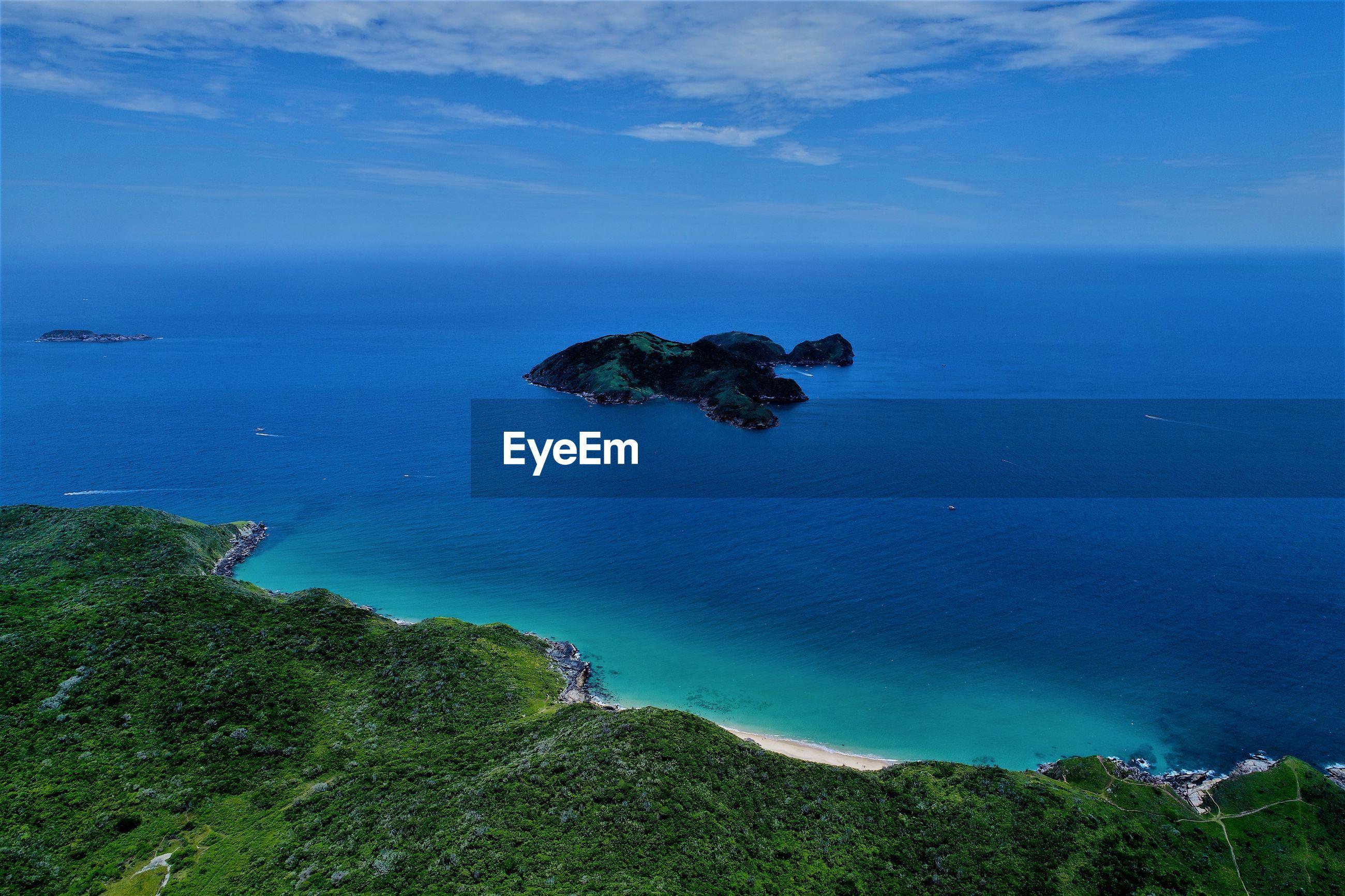 HIGH ANGLE VIEW OF SEA AND ROCKS