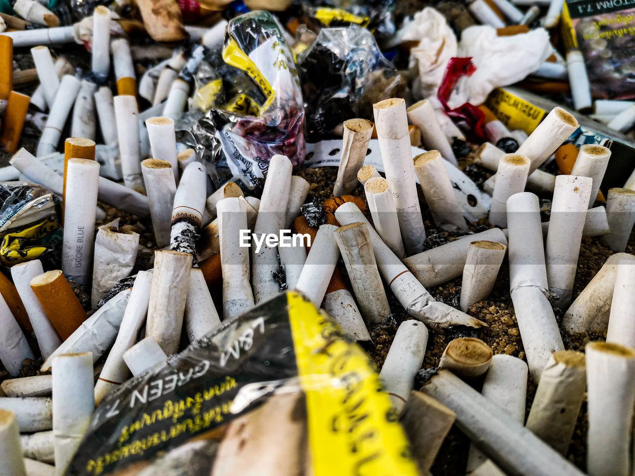 HIGH ANGLE VIEW OF CIGARETTE SMOKING