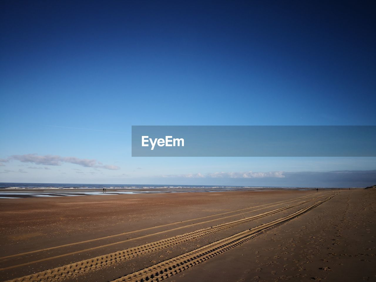sky, scenics - nature, blue, land, copy space, beauty in nature, nature, tranquility, tranquil scene, day, no people, landscape, environment, road, sand, desert, non-urban scene, transportation, horizon, outdoors, arid climate