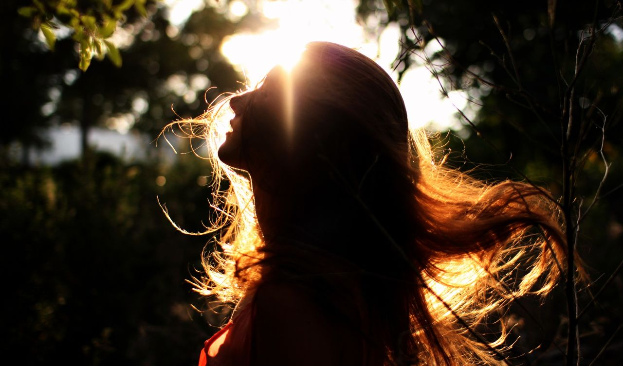 Side View Of Silhouette Young Woman During Sunny Day