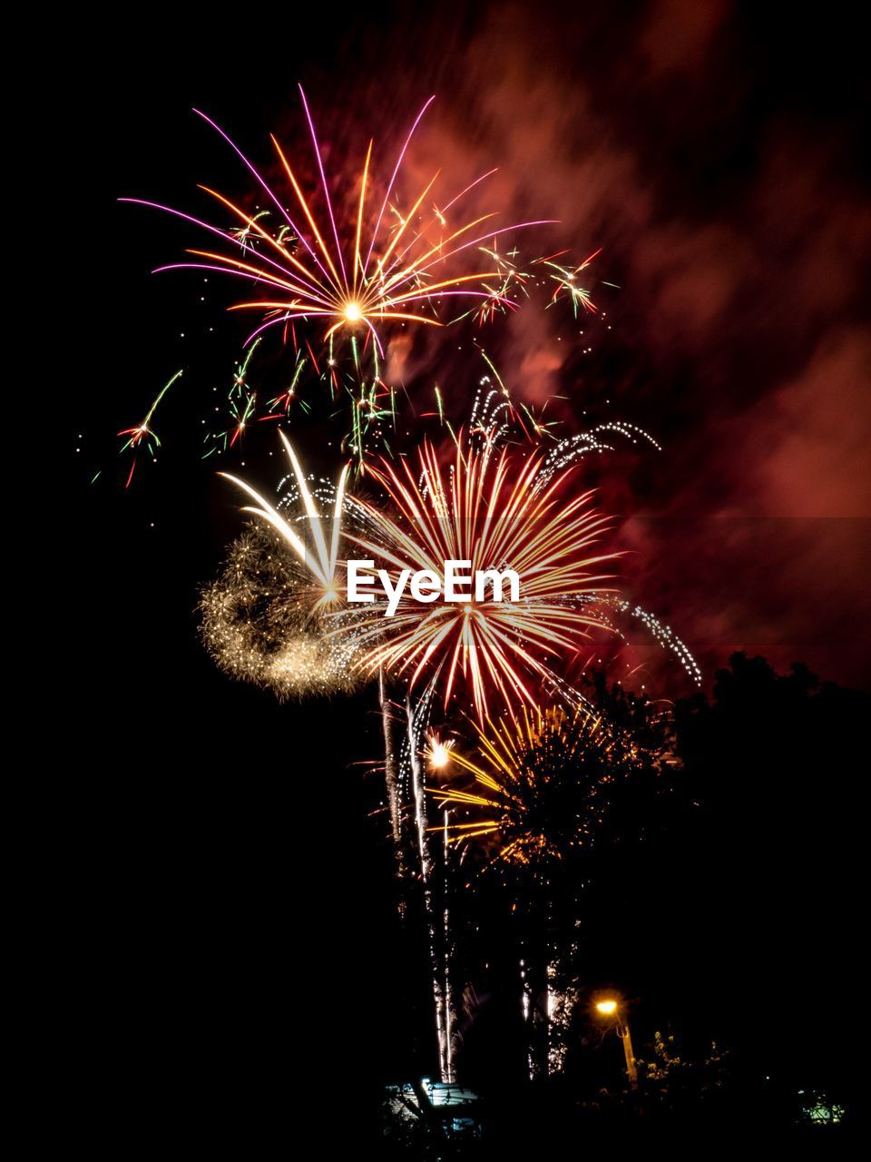 illuminated, night, firework, motion, celebration, firework display, arts culture and entertainment, event, sky, exploding, glowing, long exposure, firework - man made object, low angle view, nature, light, no people, blurred motion, multi colored, outdoors, sparks