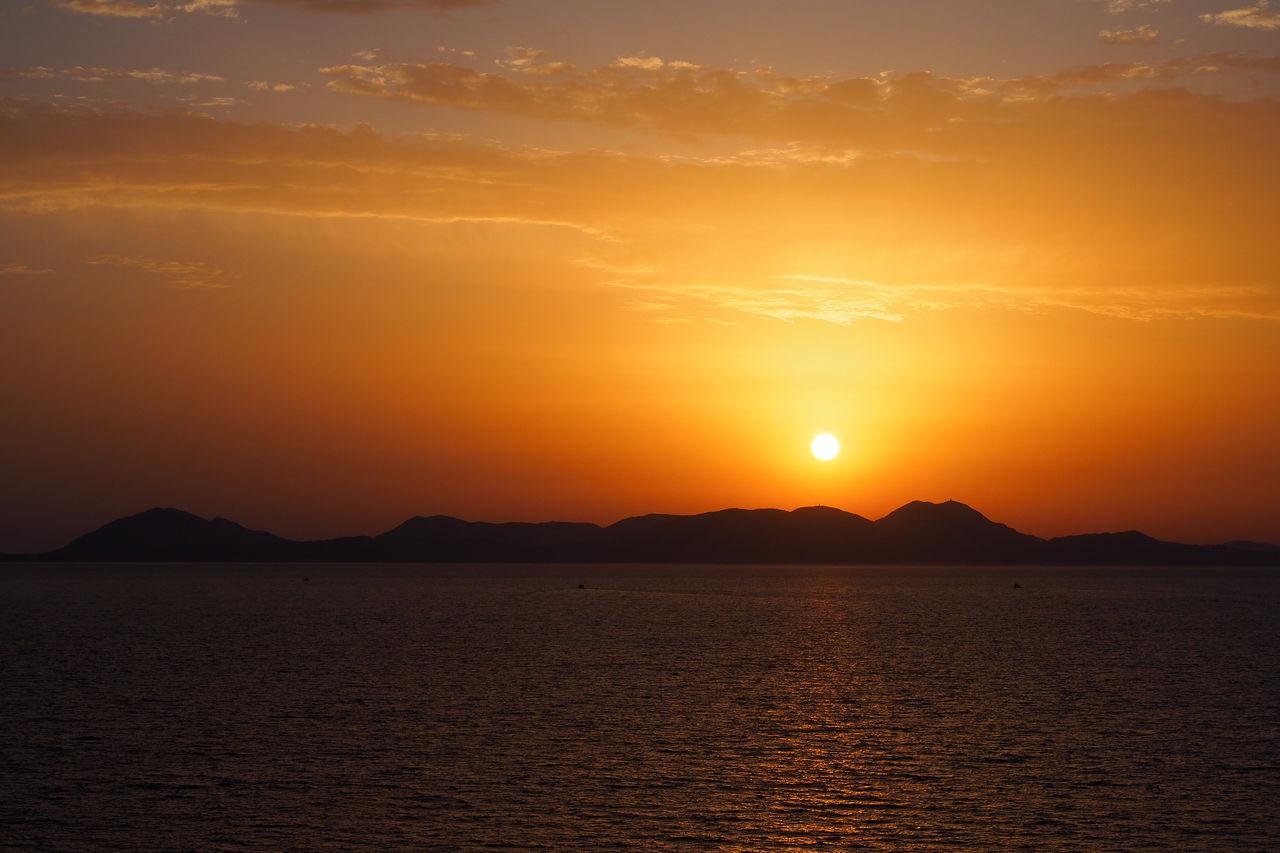 sunset, sky, beauty in nature, scenics - nature, orange color, tranquil scene, tranquility, water, mountain, waterfront, idyllic, nature, sun, no people, sea, non-urban scene, silhouette, sunlight, cloud - sky, outdoors, romantic sky