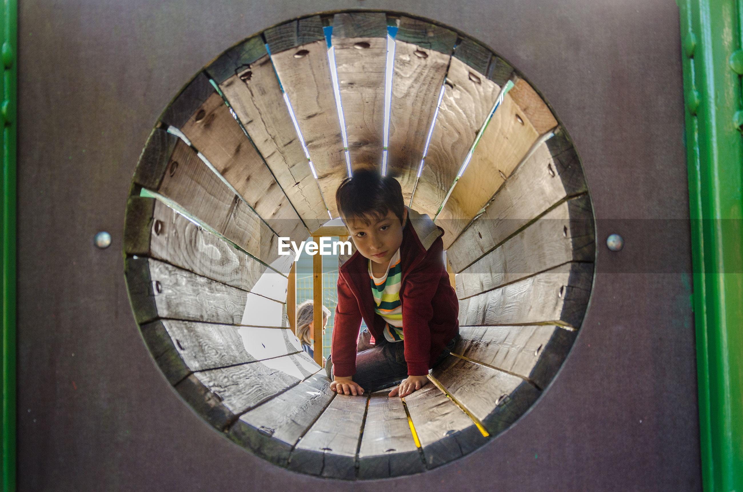 View of child playing on playground equipment