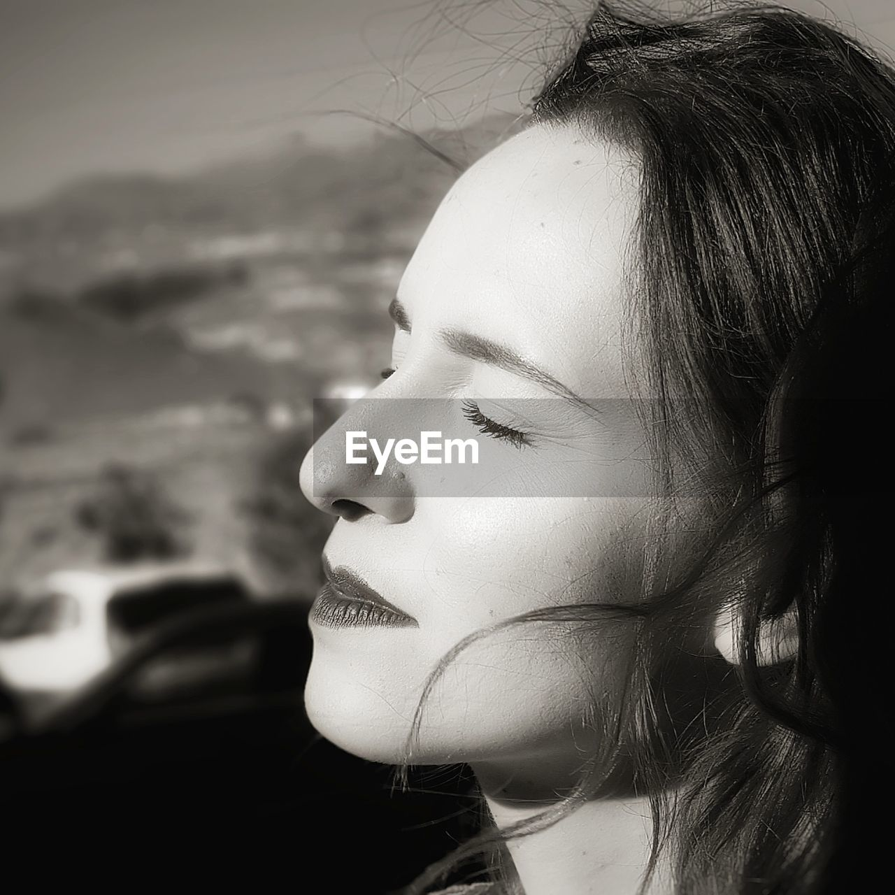Close-up of woman with closed eyes during sunny day