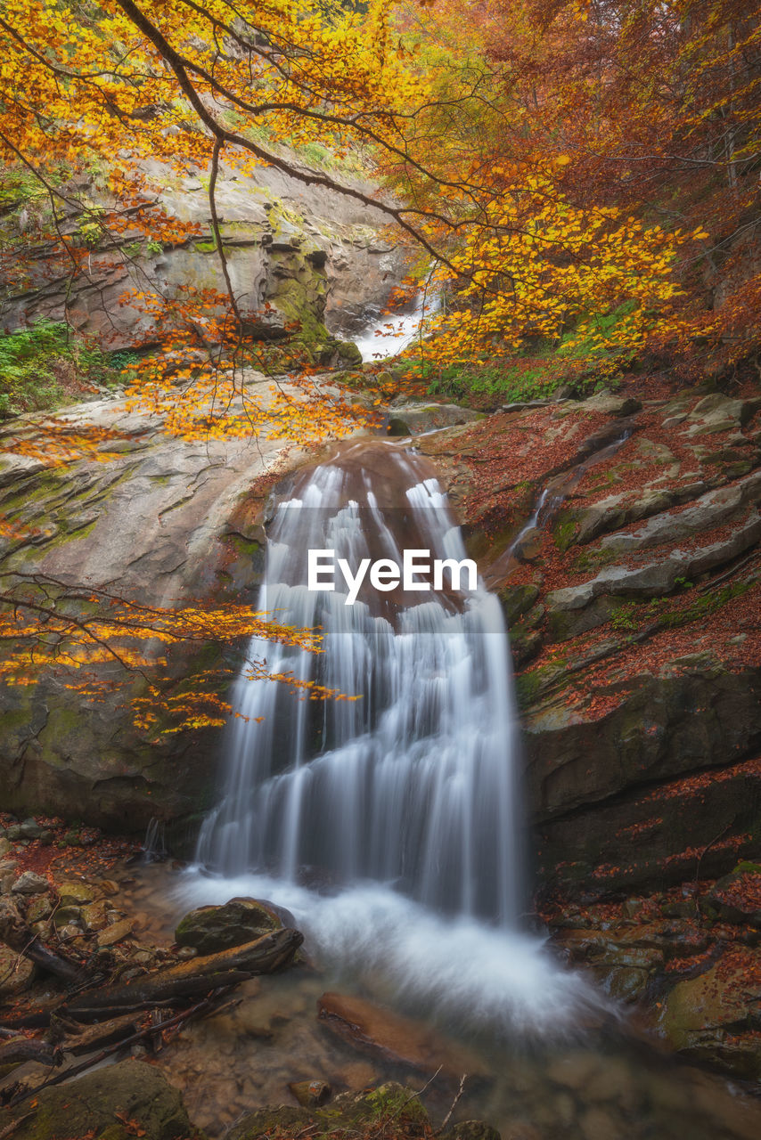 motion, long exposure, tree, scenics - nature, forest, blurred motion, waterfall, beauty in nature, autumn, flowing water, land, water, plant, solid, rock, rock - object, day, nature, flowing, change, no people, outdoors, power in nature, woodland, rainforest, stream - flowing water, falling water