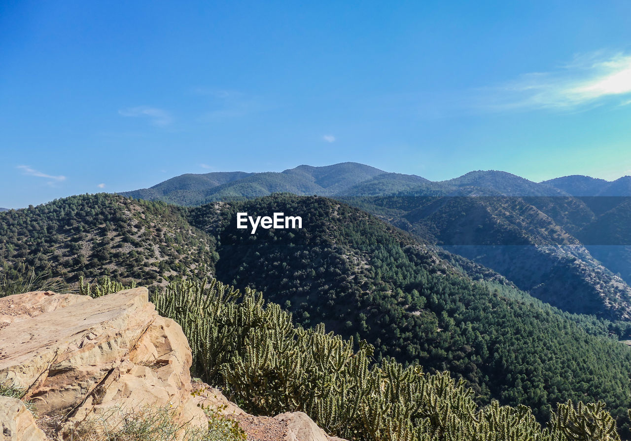 mountain, scenics - nature, beauty in nature, sky, tranquil scene, tranquility, non-urban scene, environment, mountain range, nature, plant, tree, landscape, day, no people, cloud - sky, green color, idyllic, remote, rock, outdoors, mountain peak