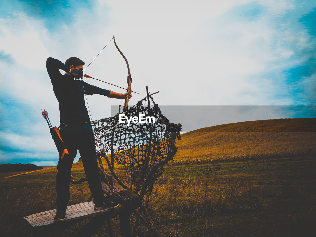 sky, real people, standing, nature, one person, men, environment, field, holding, land, full length, landscape, lifestyles, cloud - sky, day, plant, leisure activity, outdoors, young men