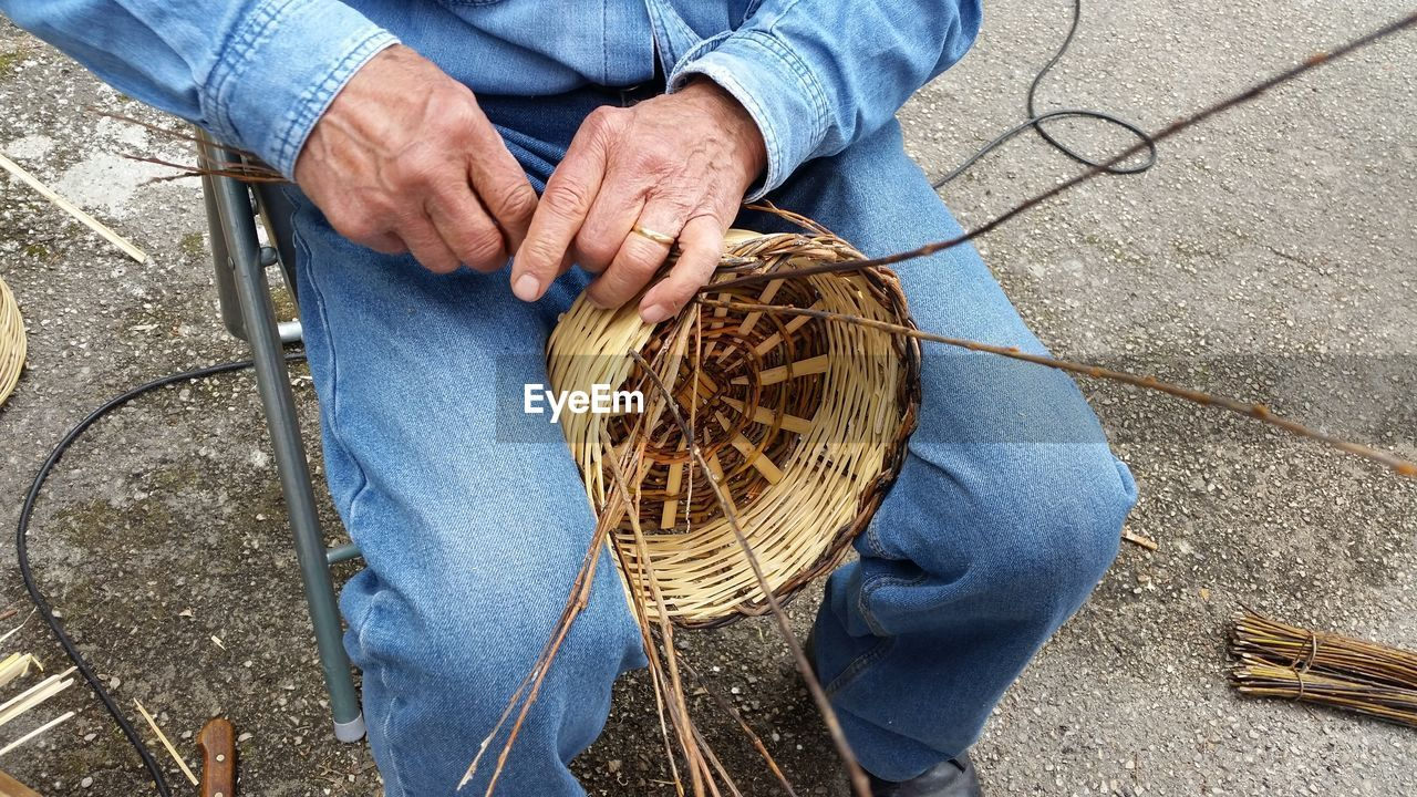 High Angle View Of Making A Basket