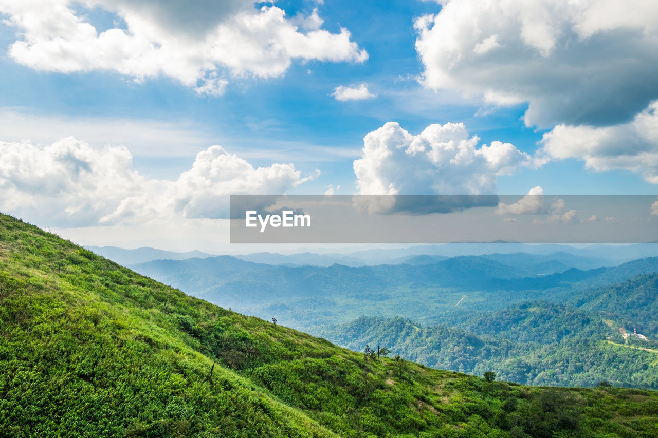 cloud - sky, scenics - nature, beauty in nature, tranquil scene, tranquility, sky, environment, landscape, green color, mountain, non-urban scene, nature, no people, land, idyllic, day, plant, remote, mountain range, outdoors