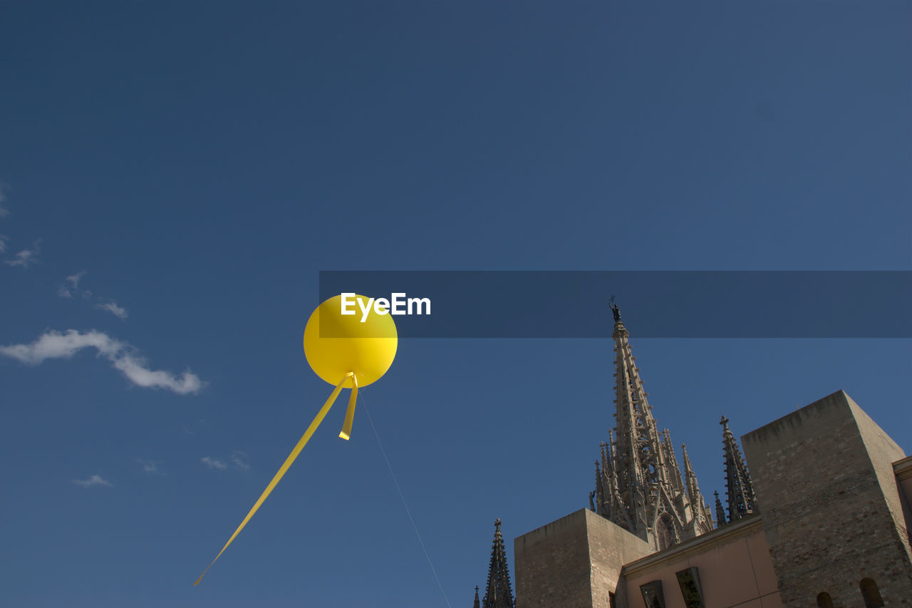 LOW ANGLE VIEW OF BALLOON AGAINST BLUE SKY