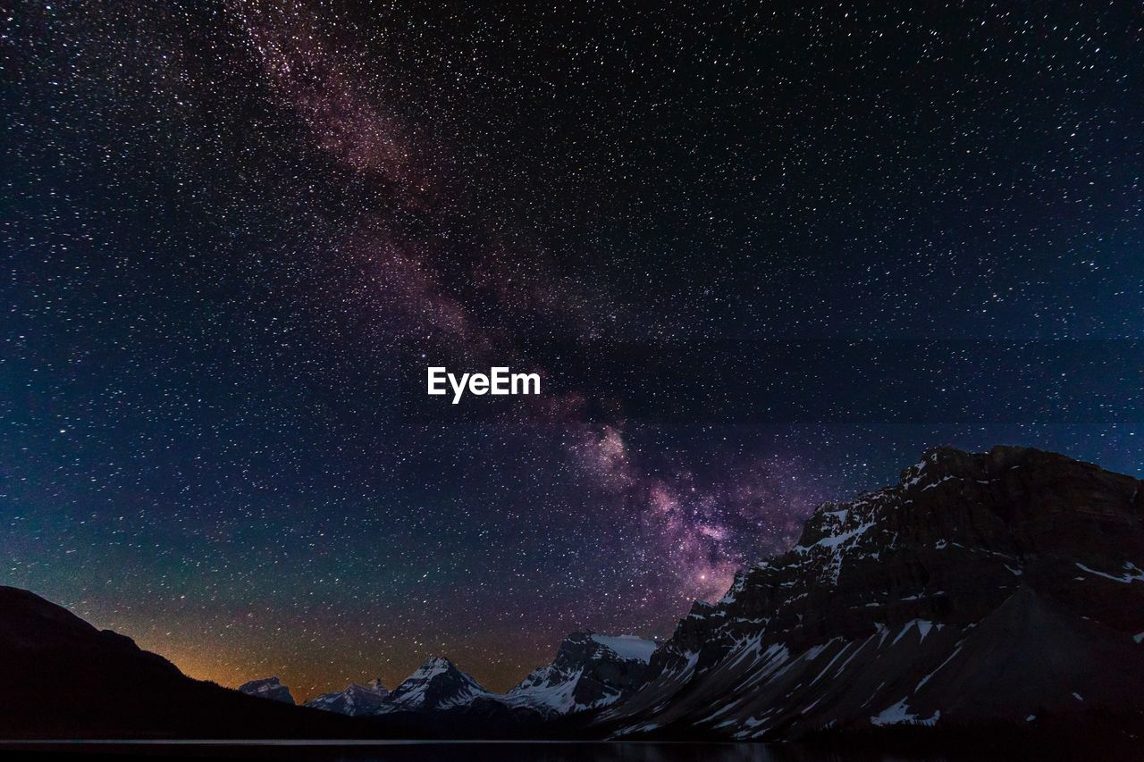 night, star - space, beauty in nature, astronomy, scenics - nature, space, mountain, tranquility, tranquil scene, galaxy, sky, nature, no people, mountain range, idyllic, star, majestic, star field, non-urban scene, low angle view, milky way, outdoors, snowcapped mountain, mountain peak, formation