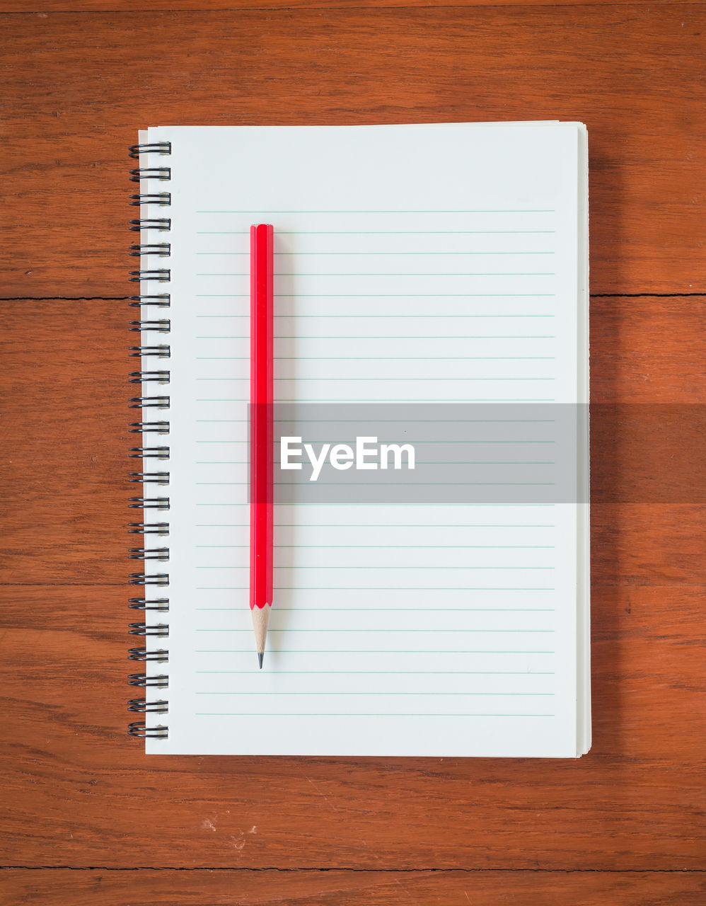 table, indoors, wood - material, directly above, no people, still life, note pad, publication, high angle view, book, pencil, education, page, spiral, spiral notebook, paper, red, writing instrument, white color, close-up, blank, wood grain