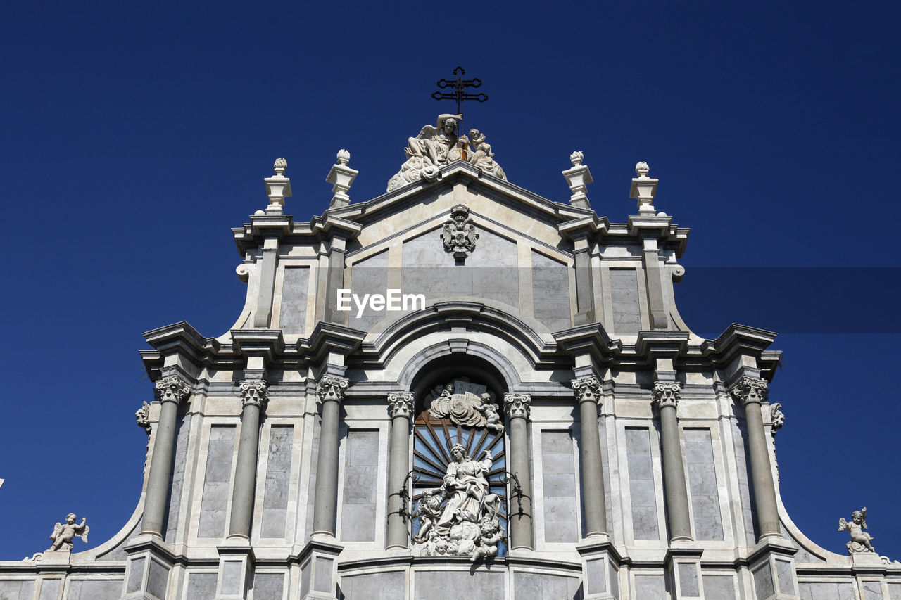Low angle view of catania cathedral against clear sky