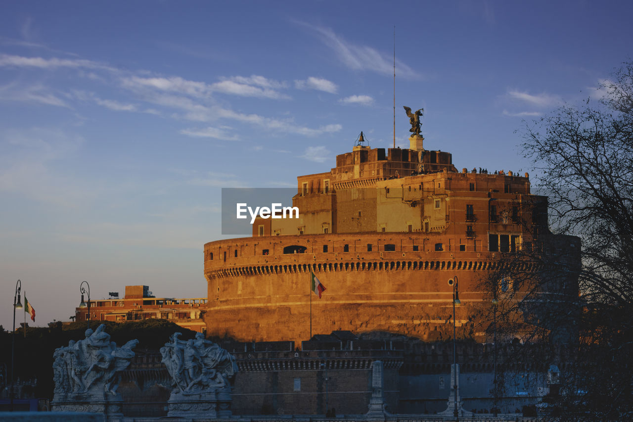 architecture, built structure, building exterior, sky, water, building, history, the past, nature, cloud - sky, travel destinations, castle, tree, day, fort, no people, travel, city, waterfront, outdoors