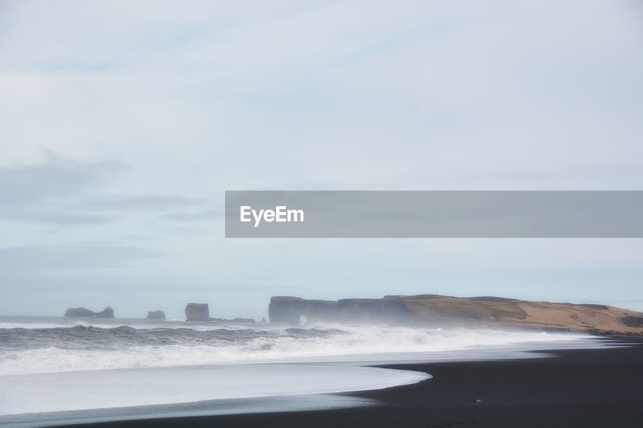 Scenic View Of Waves Breaking On Shore