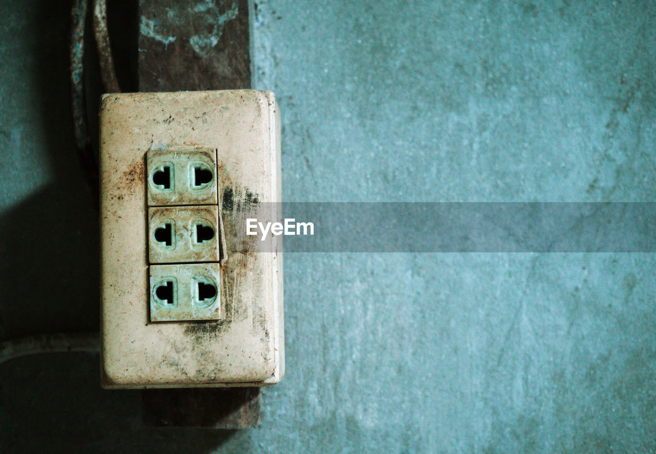 Close-up of old electrical switch on wall