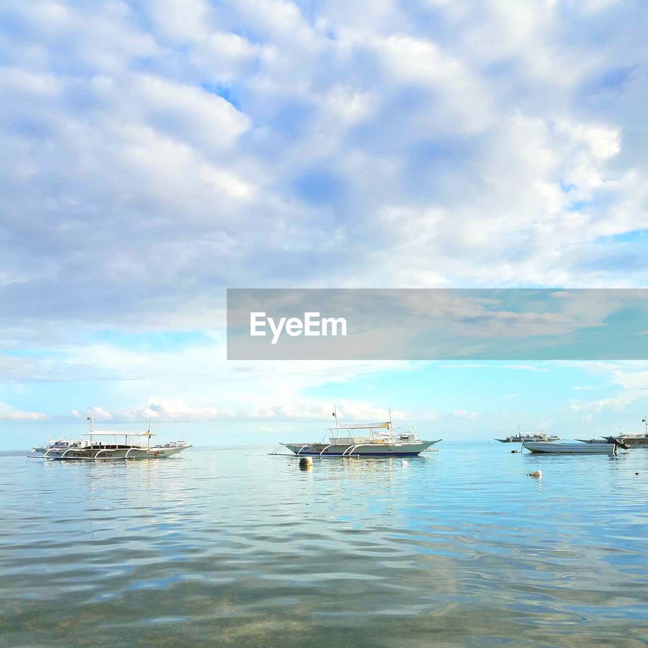 VIEW OF BOATS IN SEA AGAINST SKY