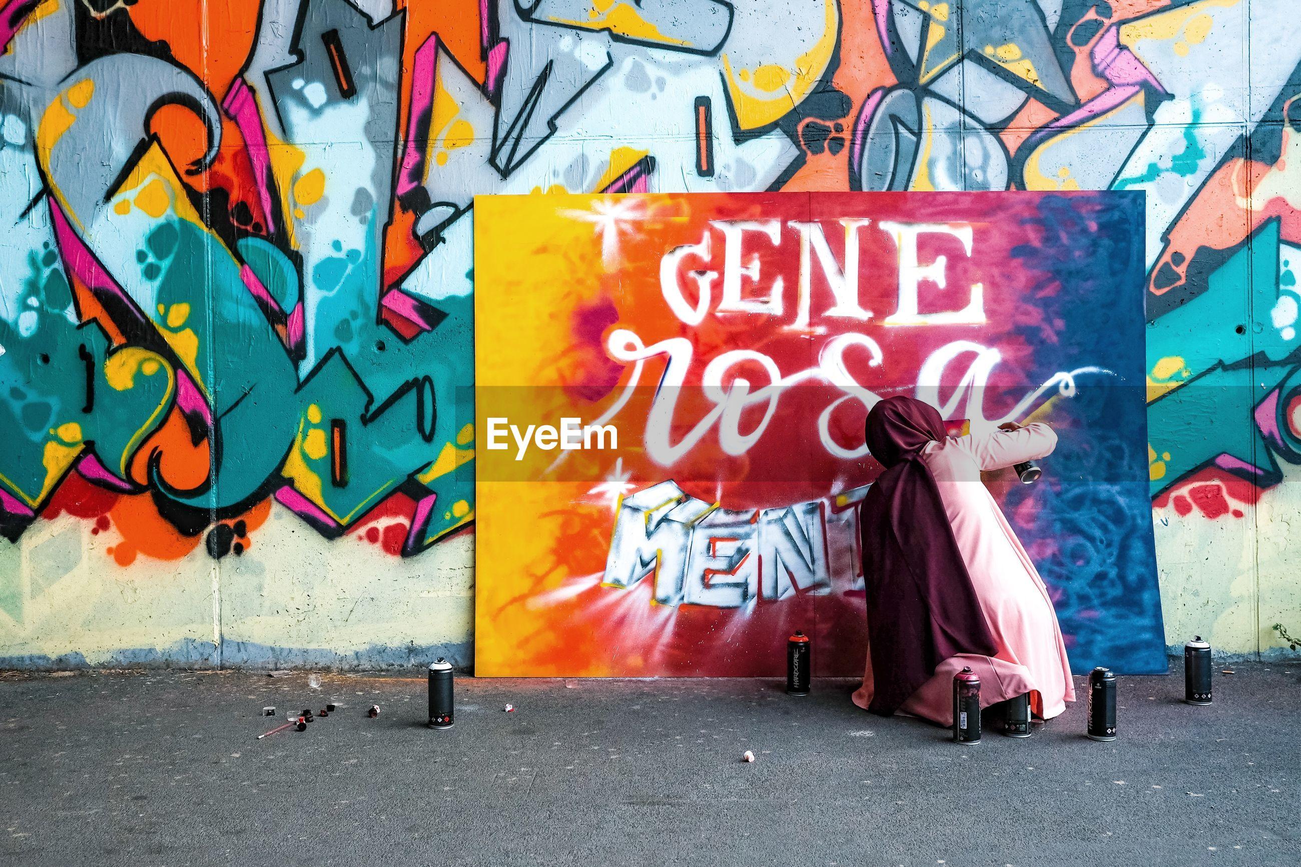 GRAFFITI ON WALL IN CITY STREET