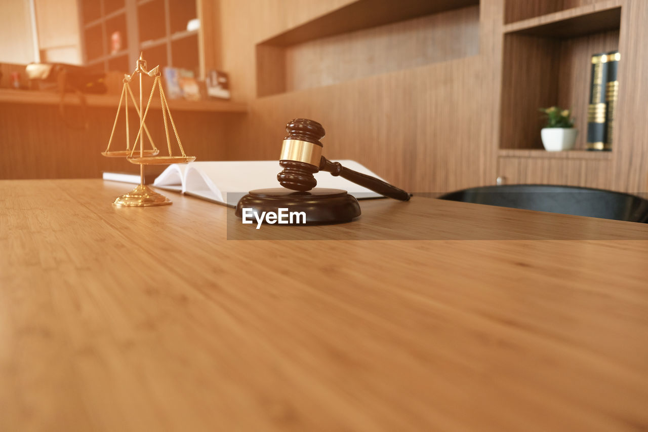 wood - material, table, indoors, no people, still life, selective focus, close-up, home interior, absence, day, architecture, book, nature, brown, time, built structure, publication, food and drink, technology