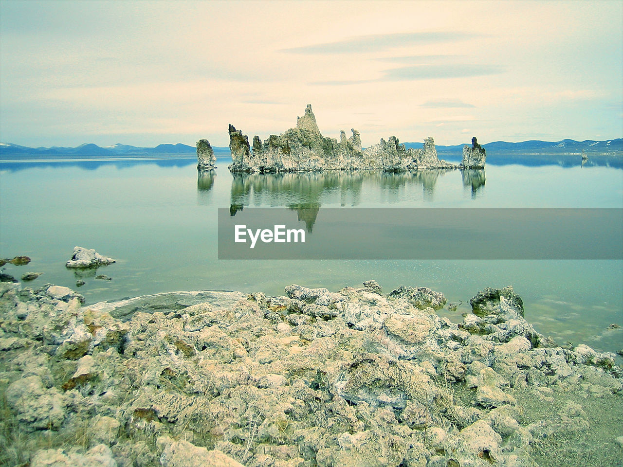 Scenic view of mono lake against sky