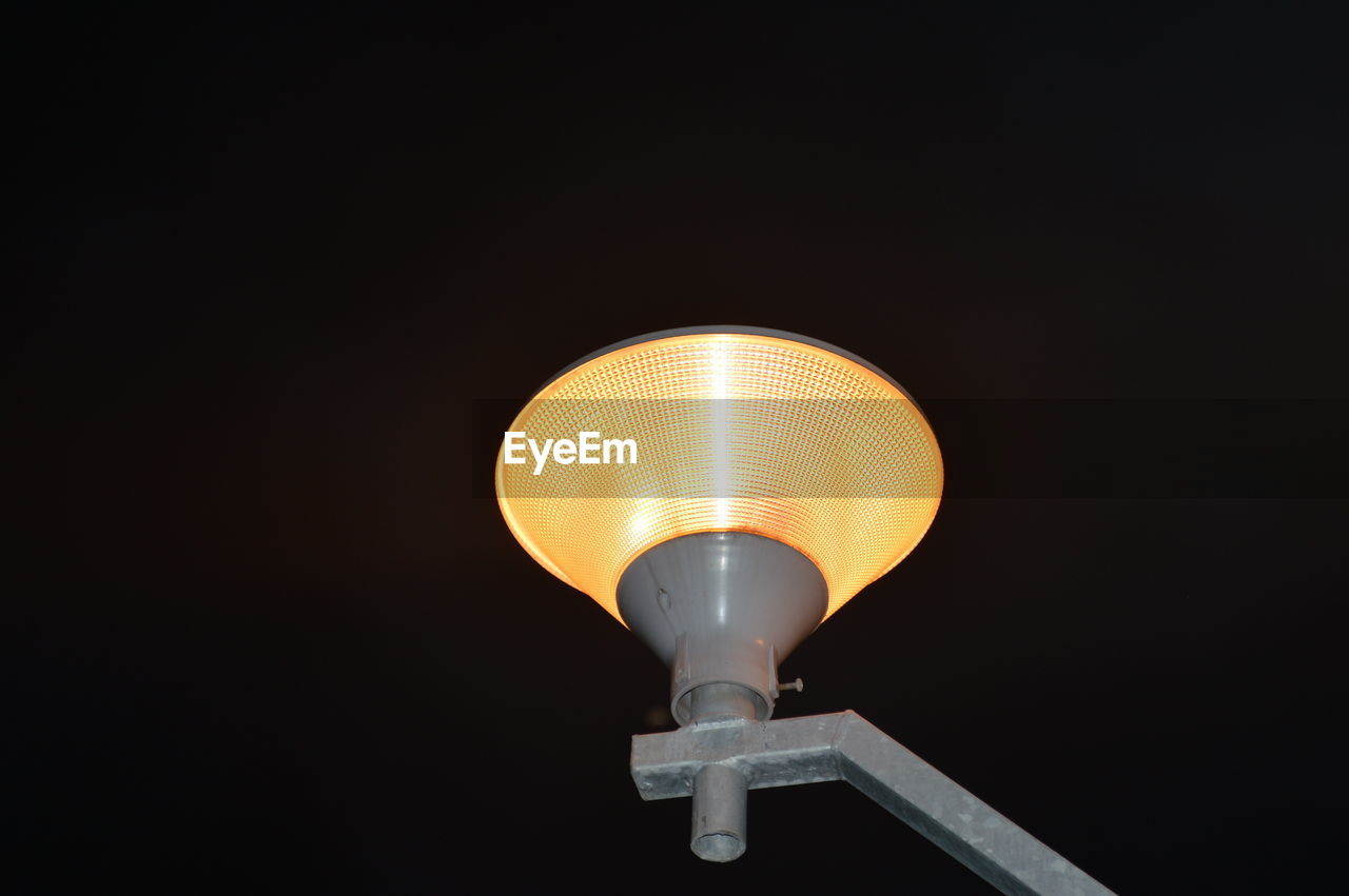 lighting equipment, illuminated, copy space, low angle view, electricity, glowing, night, no people, light, electric light, technology, street light, orange color, sky, street, indoors, dark, electric lamp, light - natural phenomenon, nature, electrical equipment