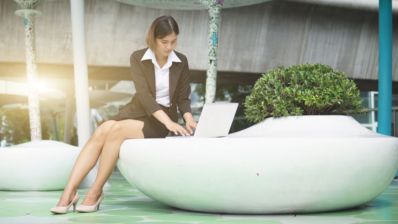 laptop, wireless technology, computer, one person, young adult, sitting, real people, communication, using laptop, adult, technology, business person, business, connection, women, young women, well-dressed, businesswoman, indoors, working, surfing the net