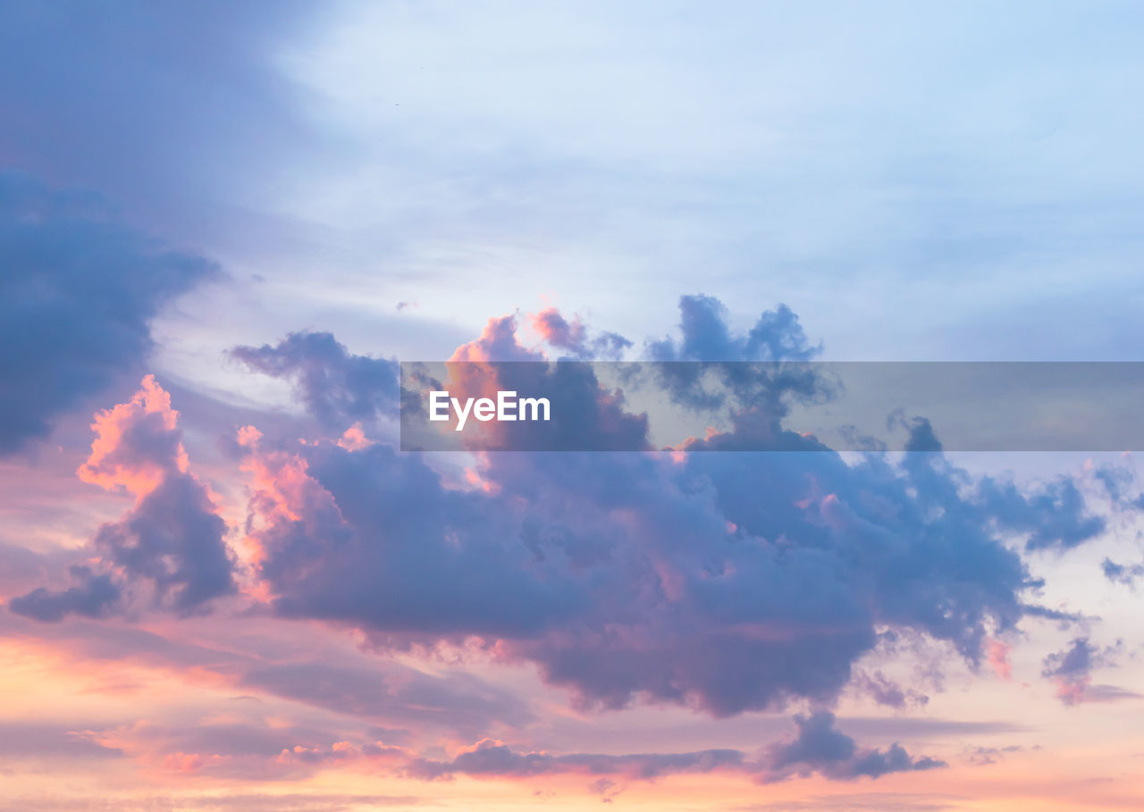 cloud - sky, sky, beauty in nature, tranquility, sunset, scenics - nature, tranquil scene, low angle view, no people, nature, idyllic, outdoors, backgrounds, orange color, dramatic sky, full frame, day, cloudscape, sunlight, meteorology