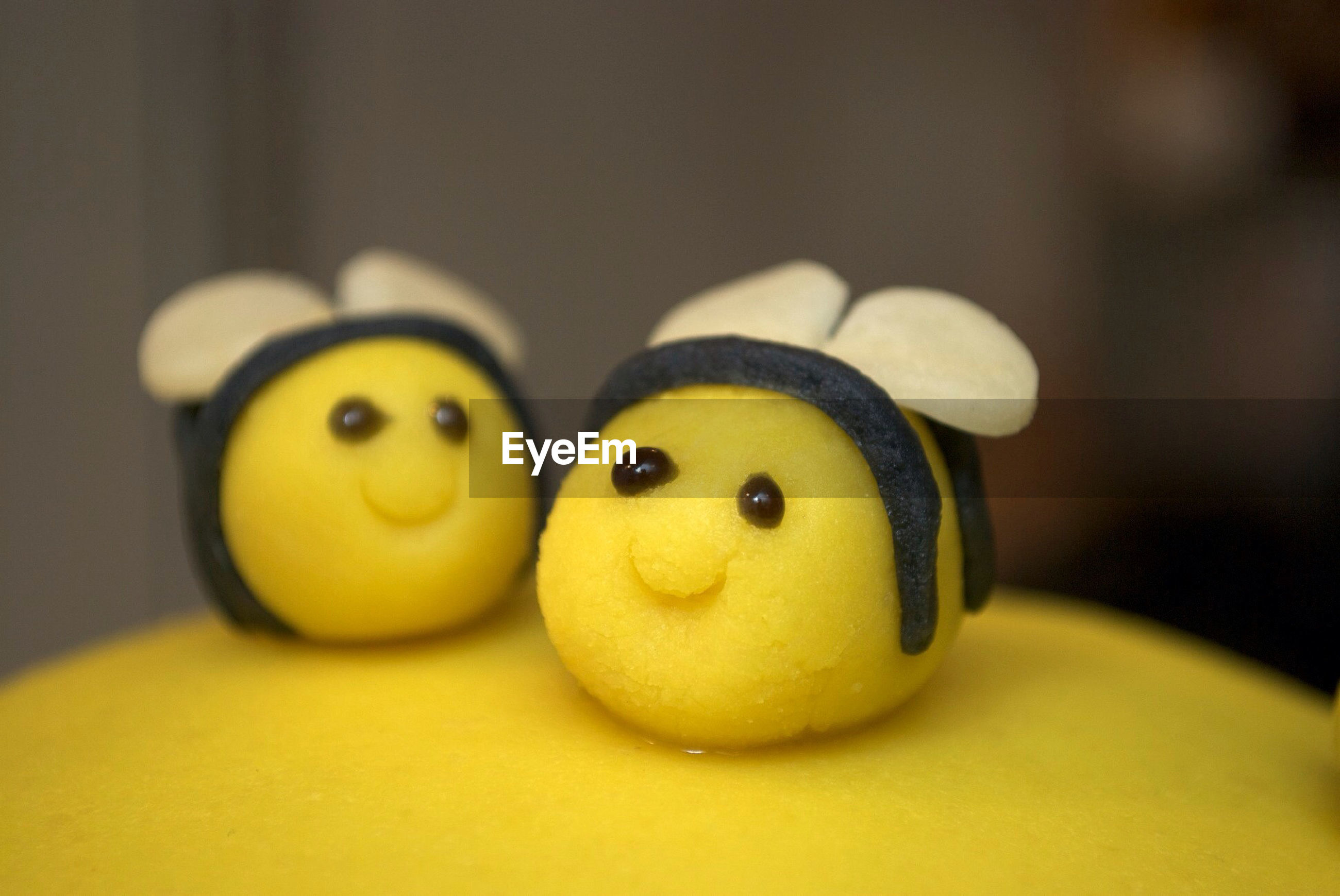 indoors, yellow, no people, close-up, focus on foreground, food, anthropomorphic smiley face, anthropomorphic face, freshness, day