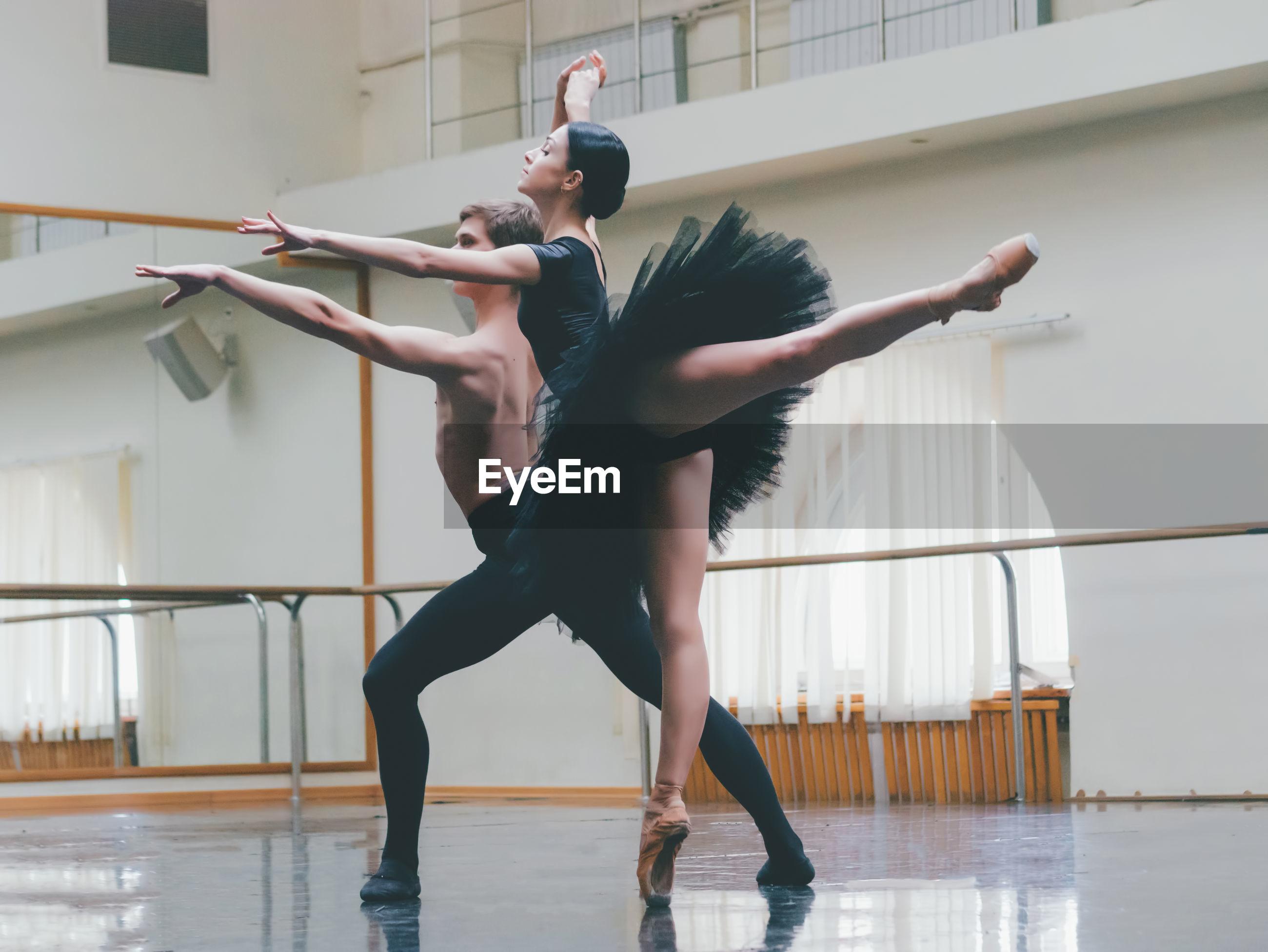Ballet dancers dancing in studio