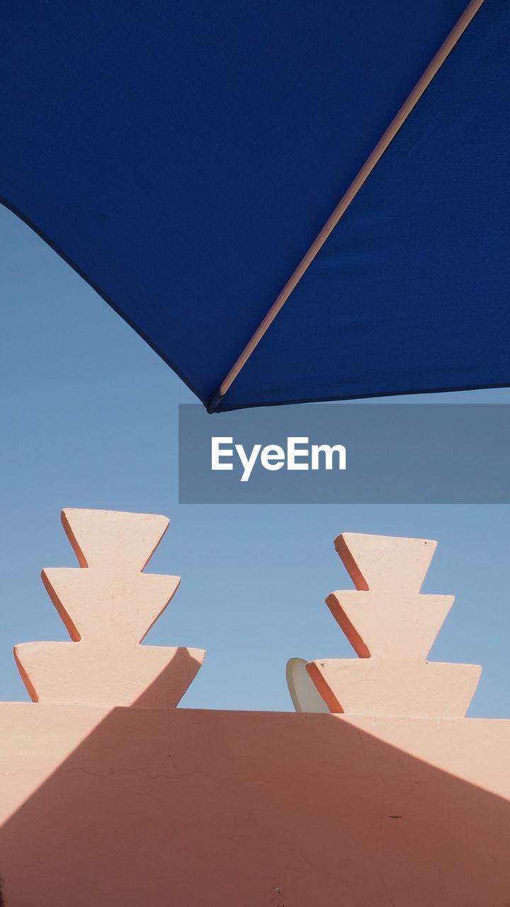 Umbrella Against Clear Blue Sky