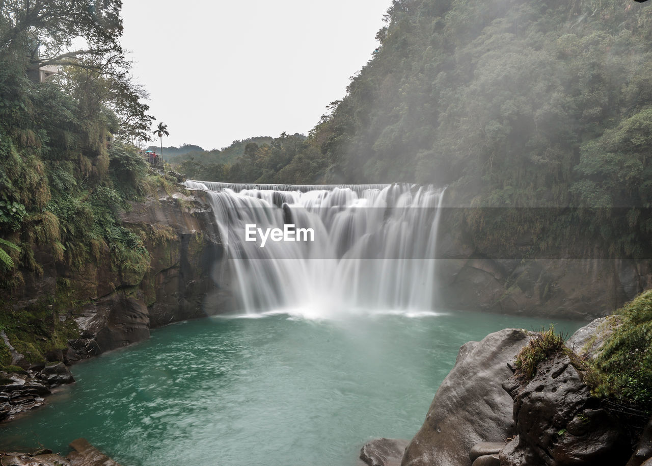 water, waterfall, scenics - nature, long exposure, beauty in nature, tree, flowing water, motion, plant, forest, power, nature, power in nature, flowing, rock, blurred motion, land, environment, no people, outdoors, rainforest, falling water