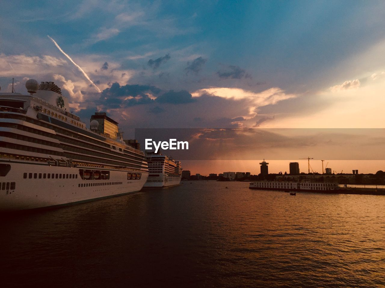 sky, water, cloud - sky, nautical vessel, sunset, waterfront, sea, transportation, ship, mode of transportation, cruise ship, cruise, architecture, nature, no people, passenger craft, freight transportation, built structure, building exterior