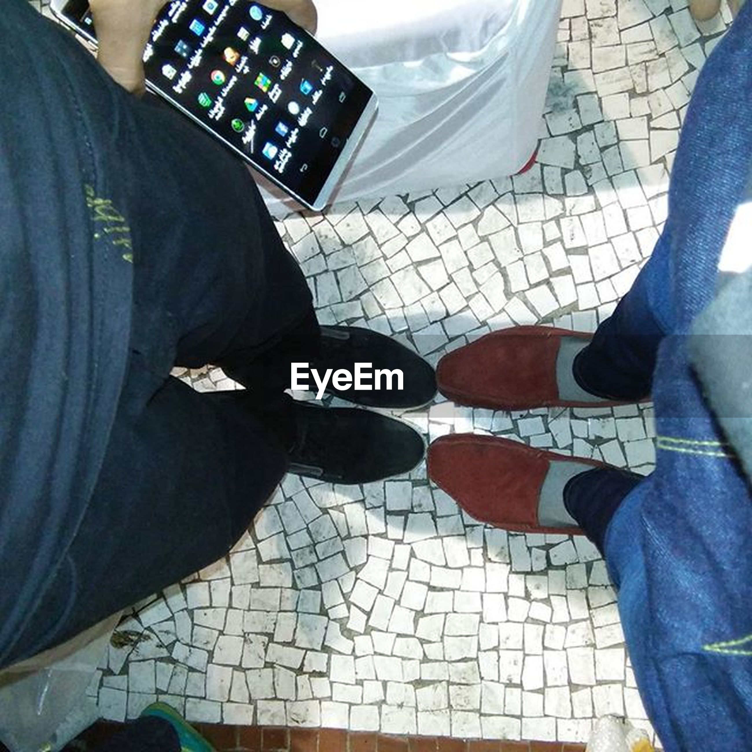 low section, person, lifestyles, men, shoe, standing, jeans, high angle view, leisure activity, indoors, casual clothing, human foot, personal perspective, footwear, unrecognizable person