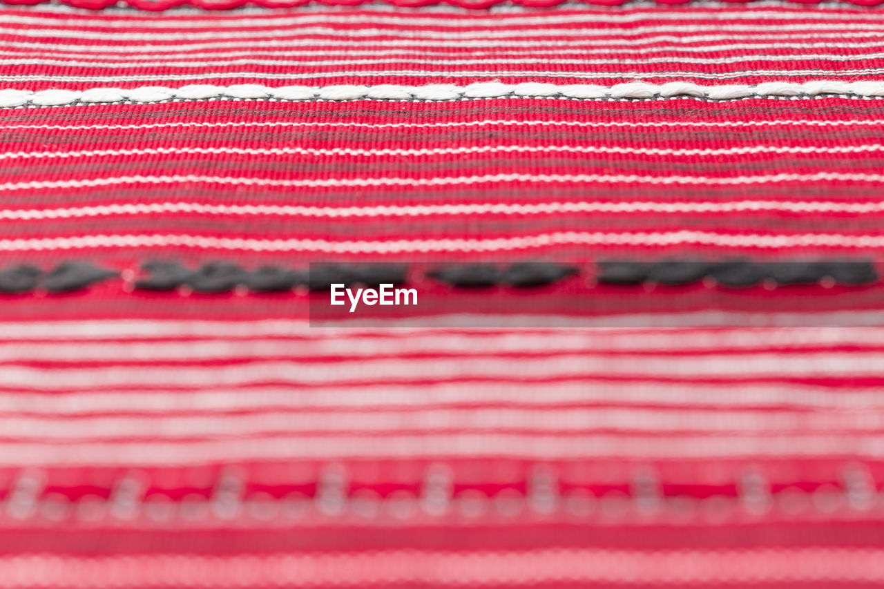 red, pattern, no people, textile, backgrounds, close-up, full frame, winter, selective focus, food and drink, striped, extreme close-up, food, indoors, industry, macro, pink color, magnification, man made, blue, warm clothing