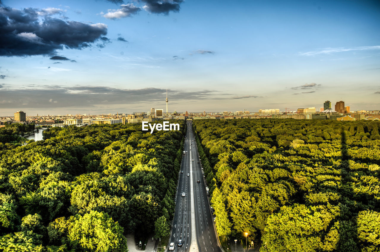 Aerial View Of City Street Amidst Trees Against Sky